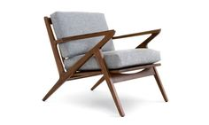 Natural solid wood and premium upholstery take you back in time with this retro, luxurious lounge chair.