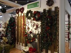 Luxurious wreaths and garlands ornamented with delicate berries, stunning red flowers, and realistic cones.