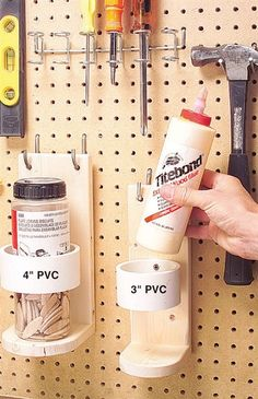 Clever storage from bits and pieces: PVC pipe and wood bracket mounted to pegboard for storage in garage