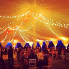 Bistro lights strung in beautiful tent at the South Terrace at the Biltmore Estate