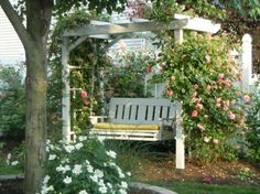 Arbor swing pergola - such a cute spot in the garden with climbing roses eclecticallyvintage.com