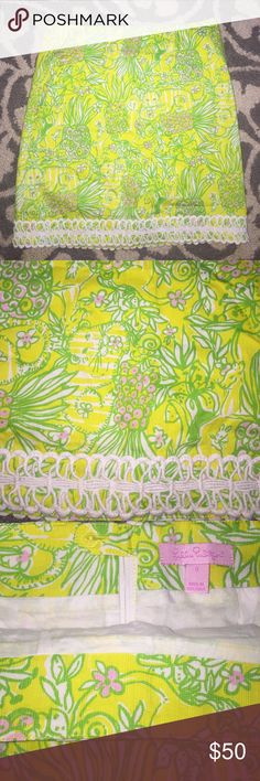Lilly Pulitzer Skirt Worn once. Super cute skirt with pineapple lion print. Shades of green and pink are shown in the yellow. Lace detail on bottom. Great condition. No stains no tears! Lilly Pulitzer Skirts
