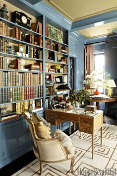Garrow Kedigiam - House Beautiful Blue lacquer bookcases, walls, and moldings, a bergere chair, and a Greek key rug by Stark in this wonderful home office.