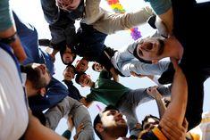 People react during a gathering celebrating Newroz in Diyarbakir (Reuters)