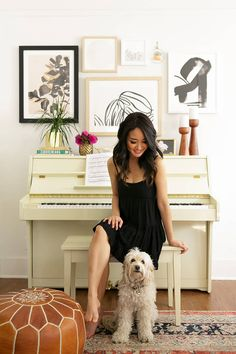 love this light yellow piano with the artwork arranged above. modern bohemian style