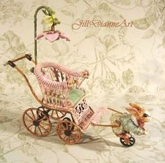 Hand-sculpted and painted rabbit pram.