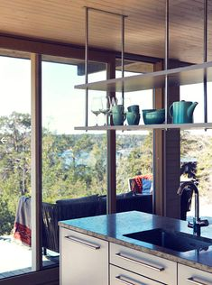 Modern Lake House Kitchen With Suspended Shelves