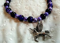 Hey, I found this really awesome Etsy listing at https://www.etsy.com/listing/228561922/unicorn-necklace-pegasus-necklace-purple
