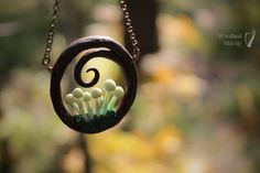 Swirl necklace with light green mushrooms by titaniaUMN