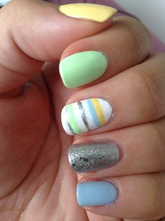 Pastel mani with silver and stripped accent nails.