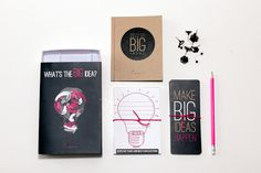 The stationery kit consists out of push pins, 'idea' themed bookmarks, 'idea' themed postcards, an 'idea' themed kraft notebook and a branded electric pink pencil. Corporate Branding, Corporate Gifts, Seating Cards, Stationery Design, Instagram Shop, Brand Identity, Bookmarks, Postcards, Electric