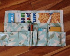 DIY purse organizer. On the inside for the purse, sew in pockets for checkbook/cash, one for credit cards, other additional items.  I hate to carry the extra weight of a wallet.