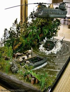 Action diorama, Helicopter dropping Military Recon and attack boats on a River in the jungle