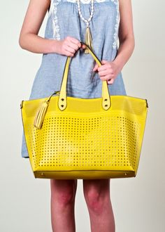 Urban Expressions Rowan perforated tote; yellow openwork tote featuring laser-cut faux leather with a canvas pouch inside, trendy everyday tote, beach or poolside ready bag, chic feminine tote