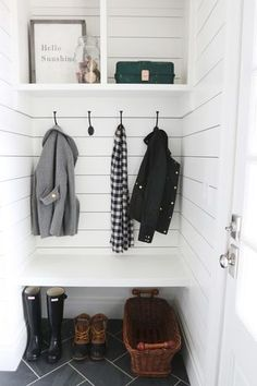 Traditional Mud Room with 6 in. x 12 in. charcoal porcelain floor and wall tile, Built-in bookshelf, High ceiling