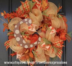 Personalized Fall Wreath - Personalize your front door with one of our custom wreaths. We can add any letter and paint it just about any color. We have several Fall mesh colors if you want to pick your mesh colors as well. The wreath measures approximately 22 inches but we can do a larger version for $80. Message us to start your custom order. (NOTE: Custom orders take a little longer to make. We try to have the ready to ship within 5 days provided all materials are available.)