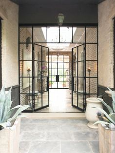 Steel and glass doors on an old brick building