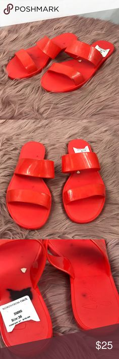 Joie Jelly Sandals Pre-Owned with DEFECT 100% Authentic  COMES WITH NO ORIGINAL PACKAGE Women's Size: 36  Color: Neon Orange  Note: Sandals have been gently used. Stains are black. Cannot be removed. (But the foot will cover the stain while wearing) Signs of scuffs. Joie Shoes Sandals