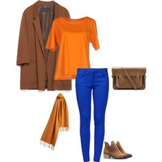 The colors of this outfit come straight from the warm springcolor palette. I styled this color combo based on a complementarycolor scheme. This means that the blueand orange are opposite each other on the warm springcolor wheel.  Keep your colors bright and pure. Notice your royal blue is a br