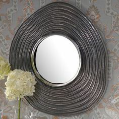 """Textured aluminum wall mirror with a wave-style frame.  Product: Wall mirrorConstruction Material: Aluminum and mirrored glassColor: NickelFeatures: Wave-style frameDimensions: 23.25"""" H x 21.25"""" W x 1.25"""" D"""