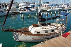 Love the teak deck (but wouldn't want the work). 1992 Pacific Seacraft Flicka 20 Sail Boat For Sale - www.yachtworld.com#.UypD9bBOWt9