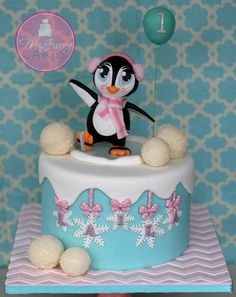 Cake with Happy Cartoon Penguin Topper