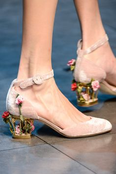 Dolce & Gabbana | this is why I am not fashionable. It looks like she stepped in gum and all this junk got stuck to her heel!