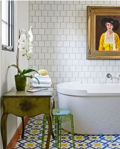 white tile dark grout bathroom with lime touches & patterned floor tiles