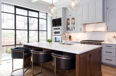 Two tone kitchen features gray inset cabinets paired with white quartz countertops and backsplash. ...