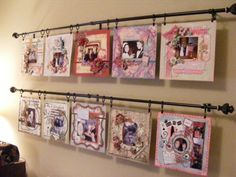 LO Display Rods - Scrapbook.com - Create display rods using curtain rods to hang up layouts until you are ready to put them in albums. #scrapbooking #crafting #diy by stefanie