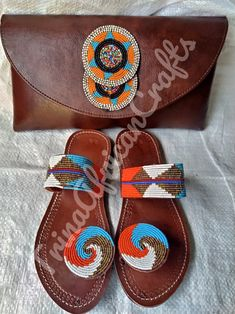 This sandals are a beautiful work of art carefully handcrafted in kenya to suit your versatile needs. the pure leather is soft to ensure comfortability to the wearer. the sandal is strong and durable made with the african rough roads in mind; additionally they have a fine touch of bead work to complete it's beautiful look. available in all sizes. the sandals come accompanied with the clutch purse. African Crafts, Beaded Sandals, Casual Bags, Clutch Purse, Kenya, Roads, Ankara, Suit, Strong