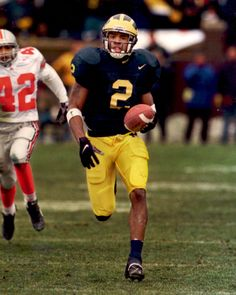 With the fourth overall selection in the 1998 NFL Draft, the Oakland Raiders select, Charles Woodson, Cornerback, Michigan. Football And Basketball, Football Players, College Football, Basketball Floor, Bears Football, University Of Michigan Athletics, Michigan Wolverines Football, Charles Woodson, Michigan Go Blue