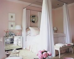 Dreamy!  I've always dreamed about curtains on the bed.
