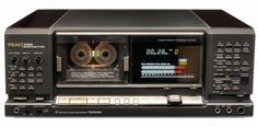 """The Teac Z-7000, their last high end tape deck. 17,9kg of diecast zinc alloy for the entire frame and drive assembly plus the sides and top quarters covered with wood. Also four motors, three heads, two closed-loop capstans and all of the future, too : the no less than mirific """"Computomatic"""" system allowed to keep all settings in memory and visualize everything on a huge display window as well as search and memorize tracks"""