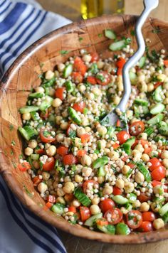 This chickpea tabbouleh combines the traditional flavors of tabbouleh with hearty chickpeas and whole wheat Israeli couscous for a simple, filling salad.