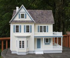 Front view of Victoria's Farmhouse in cream with blue trim.