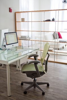 work space divided by bookcase