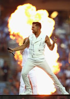 Ricky Martin performs before the 2013 NRL Grand Final match between the Sydney Roosters and the Manly Warringah Sea Eagles at ANZ Stadium on October 6, 2013 in Sydney, Australia.