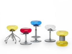 Segis | Mambo, Archirivolto Design. Stool with pivoting or fixed base of co-injected polypropylene, 80% recycled. Seat in blow moulded acrylic available in a variety of transparent colours: Clear, Red, Blue, Yellow or Aluminium lacquered. Plate underneath the seat in die cast aluminium. Mambo is available in several versions.
