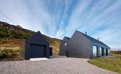 A dark craggy cliff face forms an unusual backdrop for an 'abstracted shed' characterised by black oiled Siberian larch cladding and aluminium roof sheeting. Especially one described by Mary Arnold-Forster, of Dualchas Architects, as 'distilled to the ...