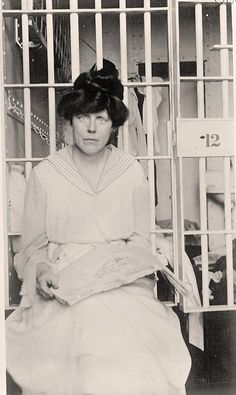 """Lucy Burns was an American suffragist  women's rights advocate.  In 1917 she was imprisoned at Occoquan Workhouse for protesting, picketing,  marching at the White House.  She endured the """"Night of Terror"""" by the guards.  The women were treated brutally  were refused medical attention.  Of the well-known suffragists of the era, Burns spent the most time in jail. Photo by Harris  Ewing. ~Fighting for Our Rights."""