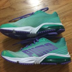 Puma running shoes size 6 These shoes are brand new with no tags attached. Only tried on inside the home and 1/2 a size too small for me. The colors are purple, teal, white, yellow and a lighter green color with the teal. Puma Shoes Sneakers