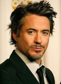 Robert Downey Jr is a 47 year old actor. He was Iron Man in the Iron Man movies, and the Avengers (with Scarlet Johansson and Chris Hemsworth). He also starred in The Sherlock Holmes movies (with Jude Law), and Due Date. Robert Downey Jr started acting at 5 years old. His dad was also an actor.
