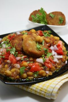 Ragda Pattice are flavorful mashed potatoes smothered with a zesty sauce made with green or white peas. It is then garnished with sweet and spicy chutneys, sev, onions and fresh coriander. Sometime...