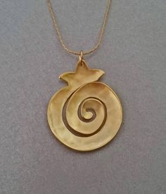 Infinity Spiral Pomegranate pendant Gold plated or Silver sterling Lea Ben Arye in the Judaical collection jewelries. Hammered by hand. Ceramic Necklace, Ceramic Jewelry, Luck Symbol, Pomegranate Art, Grenade, Infinity Symbol, Argent Sterling, Birthstone Jewelry, Cute Jewelry