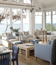 """Richardson expanded the cabin's size from 1,800 to 2,050 square feet with this window-walled addition, creating a separate living room – and taking full advantage of the home's water views. """"The whole idea behind this place is to embrace the natural environment,"""" she explained. """"It's about authentic experiences, not watching TV."""""""