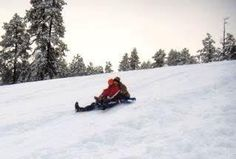 Sledding. One of my favorite childhood memories.  It brought out the child in Mom!