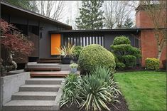 midcentury modern exterior paint - very dark grey and orange door. Design Exterior, Exterior Paint Colors, Exterior House Colors, Modern Exterior, Black Exterior, Ranch Exterior, Exterior Stairs, Modern Entry, Paint Colours