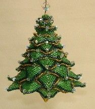 Christmas tree ornament byPaula Adams -- i need to buy the pattern and start working on it for next year