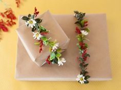 Holiday Gift Wrapping Ideas: DIY Faux Floral Gift Garland >> http://www.diynetwork.com/how-to/make-and-decorate/entertaining/14-unique-ways-to-wrap-gifts-pictures?soc=pinterest